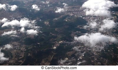 The Airplane is Flying Above the Clouds, view from the...