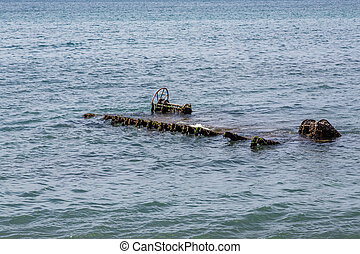 Ocean Wreckage - Old rusty wreckage in shallow water off the...