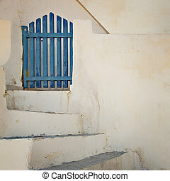 Blue gate - Image of a traditional blue wooden gate by steps...