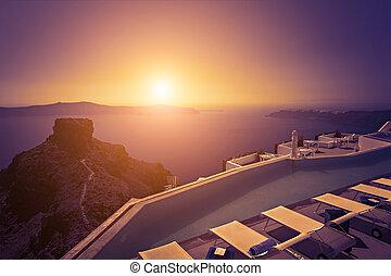 Santorini sunset - Image of a Santorini pool at sunset.