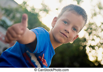 Boy Showing Thumb Up Sign