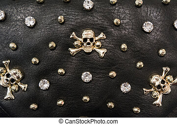 Black leather texture with metal skulls