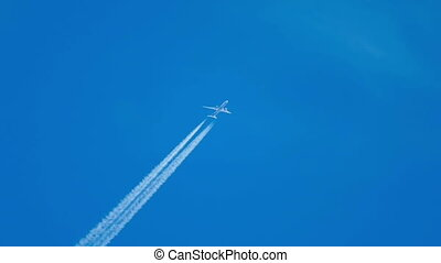Flying high - Contrails in the blue sky Boeing 777 flying...