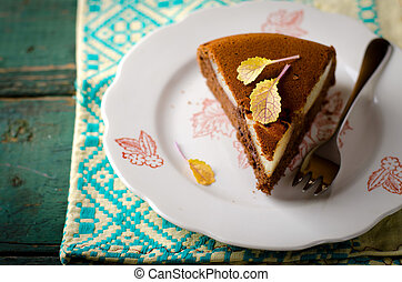 piece of homemade chocolate cake with pears and chocolate drops