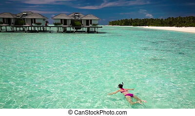 Young woman swimming in a lagoon - Young woman swimming in a...