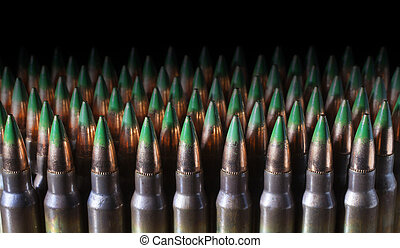 Dark cartridges - Bullets with green tips atop a lot of...
