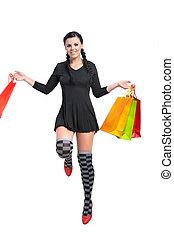 happy shopper - happy shopper jumping ower white studio shot...