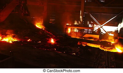 Molten metal flowing from a blast furnace - Hot steel...