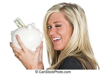 Woman Holding Piggy Bank - A blonde model holds a piggy bank...