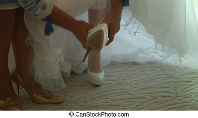 Mom puts on shoe bride wedding