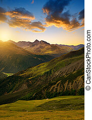Beautiful alpine landscape at sunrise Canton Graubunden,...