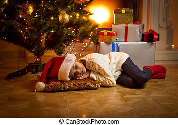 girl fell asleep under Christmas tree while waiting for...
