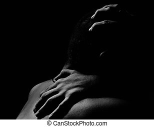young nude adult man face portrait in dark
