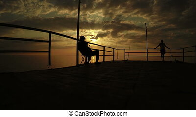 Fishermen at sunset by sea - Sunset on sea and fishermen...