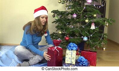 woman christmas gift box - Family woman choose gift present...