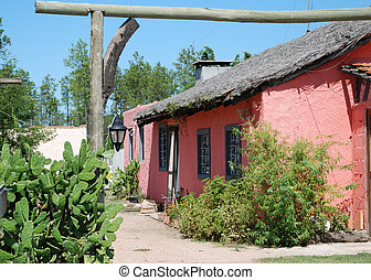 Pink hut - Traditional rural construction of uruguayan...