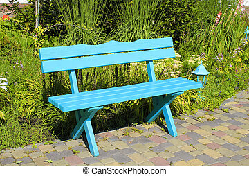 wooden park bench at the summer garden - green wooden park...