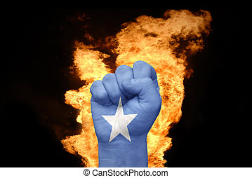 fire fist with the national flag of somalia - fist with the...
