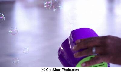 Bubble machine - A bubble machine releases bubbles