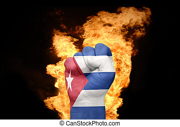 fire fist with the national flag of cuba