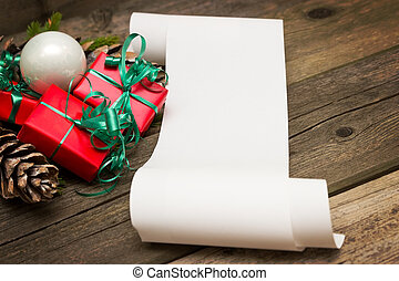 Wish list - A list of Christmas wishes next to several small...