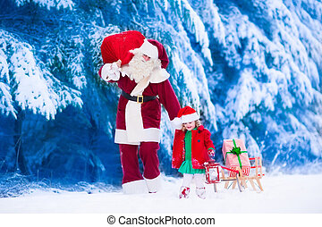 Kids and Santa with Christmas presents - Santa Claus and...