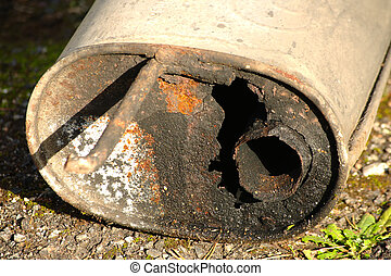 Very rusty exhaust from a car