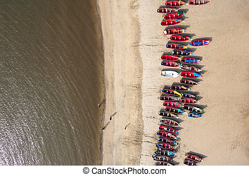 Aerial view of fishing boats in Tarrafal beach in Santiago...
