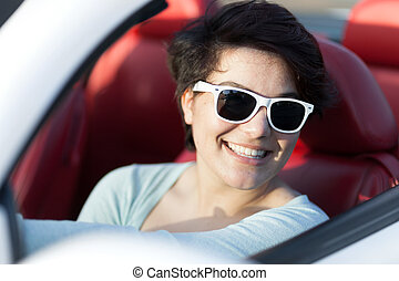 Woman Driving a Convertible