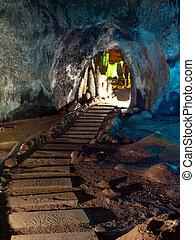 Tham Khao Bin cave - Trail with stone gate in Tham Khao Bin...