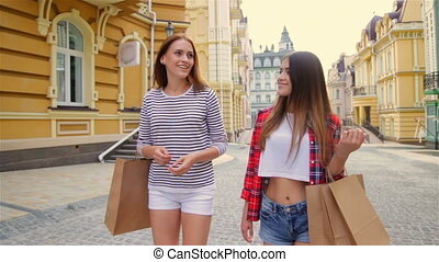 Consumerism and friendship concept - smiling happy young girls