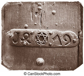 Metallic David star - Closeup of an door with Star of David...