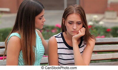 Teenage girl consoling her sad upset friend - Urban girl...