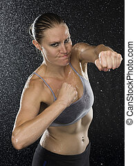 Female Fighter in Punching Pose Looking Aggressive