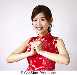 Happy Chinese New Year - Oriental girl with traditional...