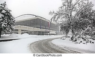 Heavy snowing in Zagreb, Croatia. Lisinski concert hall in...