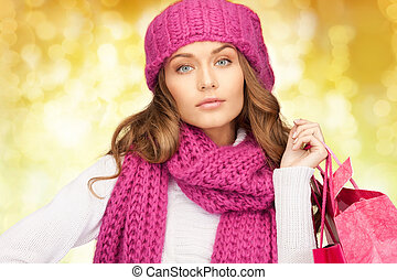 young woman in winter clothes with shopping bags - holidays,...
