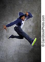 Hooded Break Dancer Jumping - Black urban break dancer...