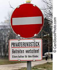 trespassing on private road - sign of a private road with...