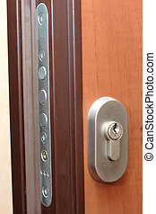 door lock - On a photo brown door and door lock