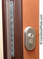 door lock - On a photo brown door and door lock