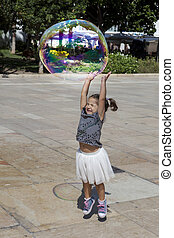 Playing in the city with a huge bubble - Three years old...
