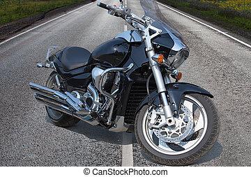 black motorcycle on highway in country - powerful black...