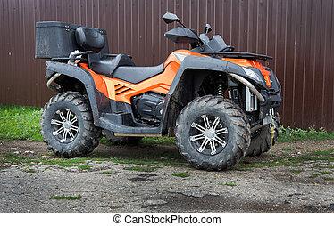powerful ATV - big powerful ATV at fence
