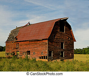 Abandoned old barn surrounded by beautiful blue sky....