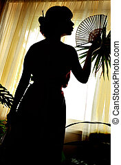 shadow-figure of oriental woman with fan near the window