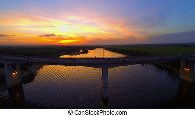 Bridge over river at sunset HD