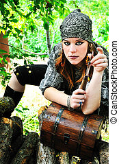 pirate girl with knife - beautiful redheaded pirate girl is...