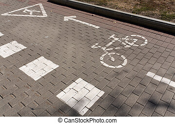 Bike path on pavement with sign.