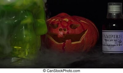 Skull container, smoke and pumpkin